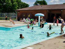 People swimming at the Fonda Swimming Pool