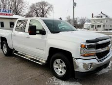 White Chevy Silverado pickup truck parked in front of S&S Auto Sales