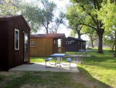 Cabins and picnic tables at Straight Park Campground