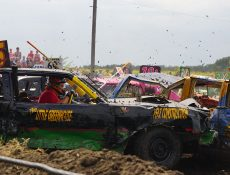 Cars crashing at a demolition derby