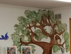 Tree mural at Gilmore City Public Library
