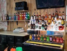 Assortment of alcohol bottles behind bar counter