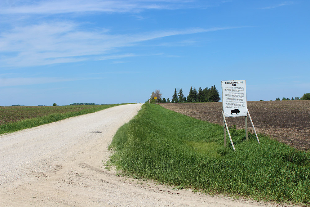 Commemorative Site sign and gravel road