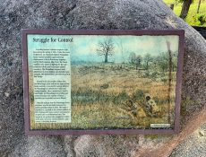 Informational sign about the last Indian battle in Iowa