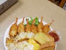Butterfly shrimp, Texas toast, and hashbrowns
