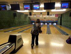 Woman bowling at Laurens Lounge & Lanes