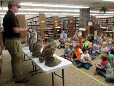 Kids attending nature presentation about owls