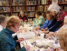 Women making jewelry
