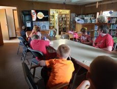 Group of children watch video about solar system