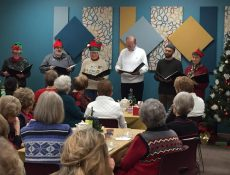 Adult choir performing at Christmastime