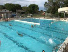 People swimming in swimming pool