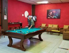 Man playing pool at Rally Point