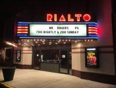 Rialto Theatre neon signs at night