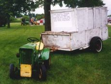 The Straight Story lawn mower and trailer