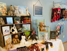 Baby leggings, books, and stuffed animals on display at William and Wesley