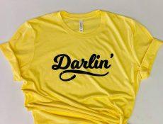 Yellow shirt that says