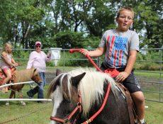 Kids riding ponies
