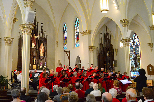 People watching a chorus performance in a church