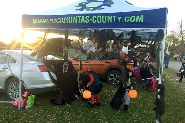 Kids in Halloween costumes at the Trunk or Treat event