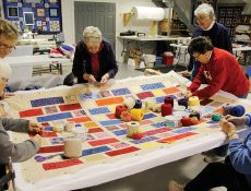 Group of women working on a quilt