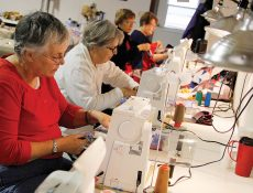 Women sewing quilts at sewing machines