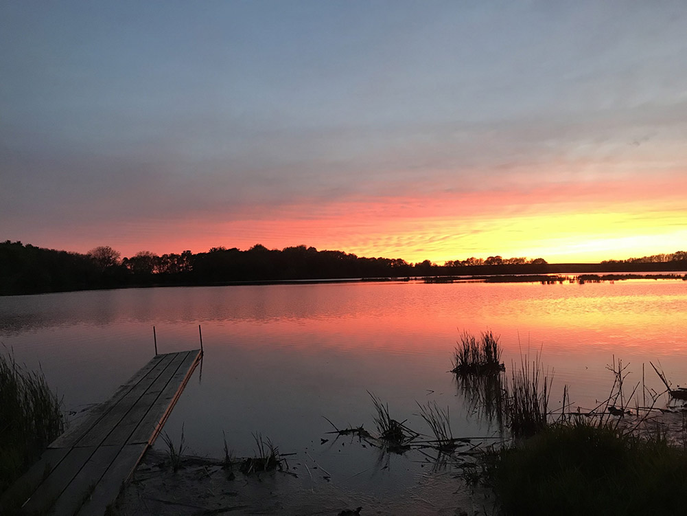 Sunset over water at Sunken Grove